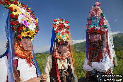 Men wearing masks, rose festival