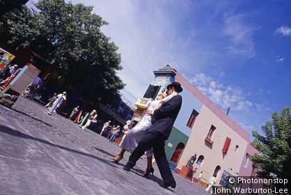 Argentina;Buenos Aires - Tango dancers in the colourful and popular area known as La Boca in Buenos Aires. La Boca (the Mouth), is located by the port.