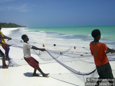 Africa, Tanzania, Zanzibar, Fishermen on the Beach.