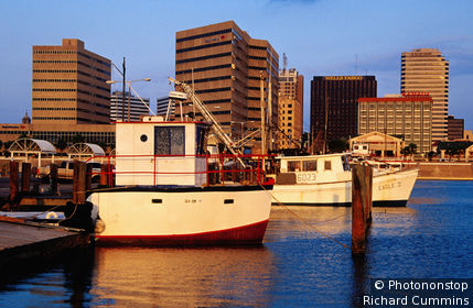 United States, Texas, Corpus Christi, Boats docked at the waterfront.