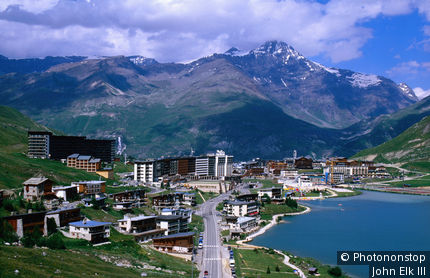 France, Rhone-Alpes, Tignes, Overhead of town and lake with mountain in background.