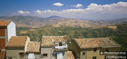 Italy, island, Sicily, island Sicily, Geraci Siculo houses detail view, mountain scenery, destination, Parco delle Madonie landscape mountains hills wideness, distance, city, residences, roofs, brick-roofs, Mediterranean, horizon, heaven, clouds