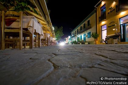 stone path at the port of Vassilikit in Greece at night