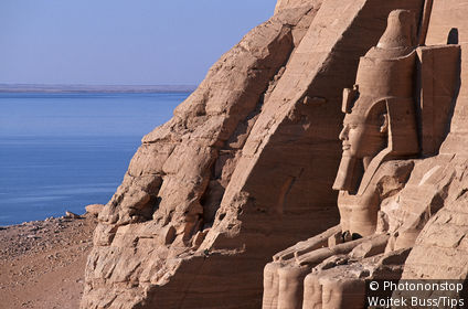 Egypt - Abu Simbel, Great Temple of Rameses II, one of the four statues of Ramesses II at the temple's gate
