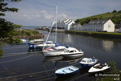 boats tied up at the mouth of the river dun in cushendun county antrim northern ireland uk