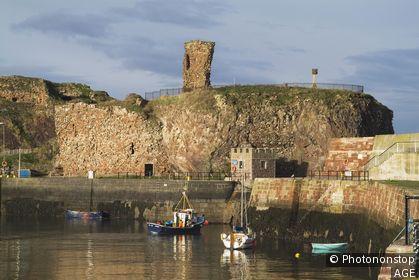Victoria Harbour DUNBAR LOTHIAN Dunbar Castle fishing boat leaving harbour