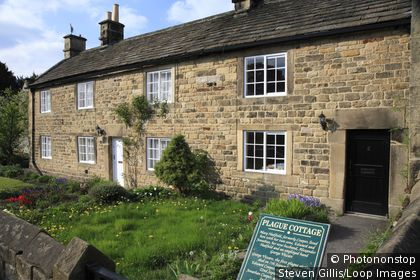 England, Derbyshire, Eyam. A row of plague cottages in the Peak District National Park.