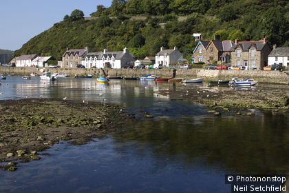 United Kingdom, Wales, Pembrokeshire, Fishguard, Buildings on harbour of Lower Town.