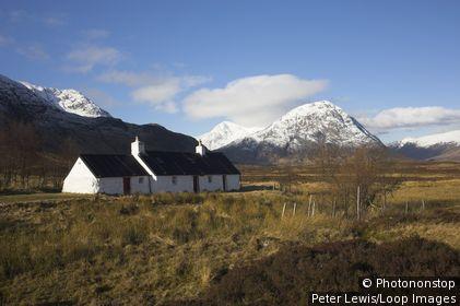 Scotland, Highland, Glencoe. Blackrock Cottage and Buachaille Etive Mor at the head of Glen Etive.