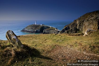 Wales, Anglesey, Holyhead. A view from the cliff top to South Stack Lighthouse at Holyhead.