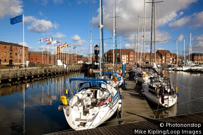England, East Riding of Yorkshire, Kingston upon Hull. Boats moored either side of a jetty in Hull Marina.