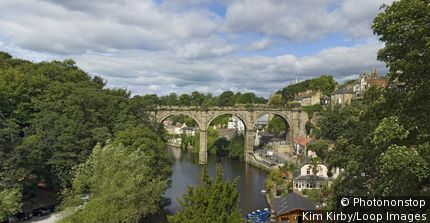 England, North Yorkshire, Knaresborough. Panoramic view of the stone viaduct across the River Nidd at Knaresborough.