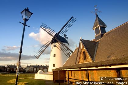 England, Lancashire, Lytham St Annes. The windmill and the former RNLI lifeboat station at Lytham St Annes. The town's bygone age and colourful past is clearly illustrated, constantly highlighting its Victorian values and unforgettable charm.