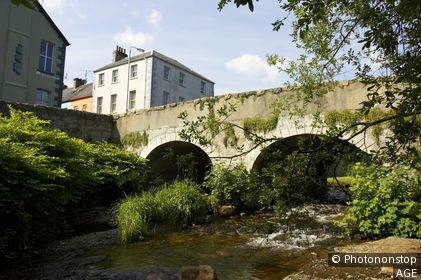 old stone bridge over the kilbroney river rostrevor village in county down