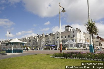 England, Merseyside, Southport. Seafront gardens and Victorian hotel in classic seaside resort in summer.