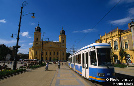 Hungary, Eastern Europe, Debrecen, Modern tram of Debrecen and the Great Reformed Church.