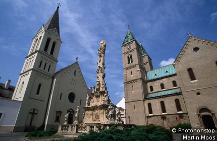 Hungary, Eastern Europe, Veszprem, The 18th century Trinity Column and Cathedral (right) on Szentharomsagter in Veszprem.