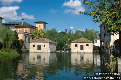 Italy, Veneto, Portogruaro, watermill on river