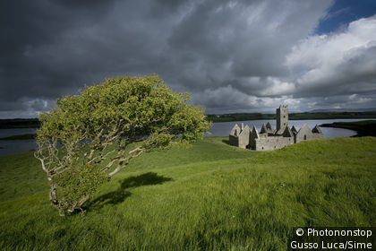Ireland, Republic of Ireland, Connaught, Ballina, Storm clouds over Rosserk Abbey.
