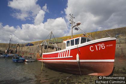 Ireland, Republic of Ireland, Munster, Helvick Head, Red fishing boat, Helvick Head Pier.