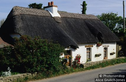 Exterior of thatched roof cottage. Kilmore Quay, Leinster,County Wexford, Ireland,Republic of Ireland