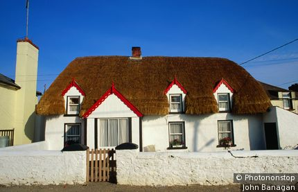 Cottage with thatched roof. Tipperary, Munster,County Tipperary, Ireland,Republic of Ireland