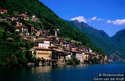 Switzerland, Ticino, Gandria, Gandria village and mountain backdrop from Lago di Lugano.