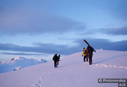 Norway, Scandinavia, Narvik, Skiiers and snowboarders hiking in mountains.