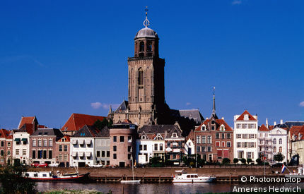 Netherlands, Overijssel, Deventer, Grote or Lebuinuschurch towers above town buildings.