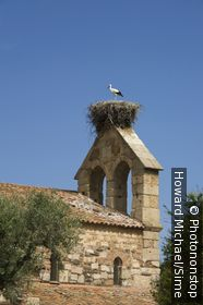 Portugal, Castelo Branco, Idanha-a-Velha, Beira, Beira Baixa - church with stork's nest in central Portugal