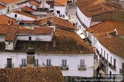 Portugal, Alentejo, Moura. View across the rooftops. The Arab influence is still visible at this peaceful town, surrounded by oaks and olive trees, particularly in the narrow streets and low whitewashed houses, with their pepperpot chimneys,
