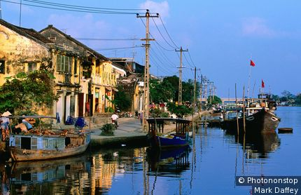 Boats moored along Thu Bon River fronting D Bach Dang Street. Hoi An, Quang Nam, Vietnam