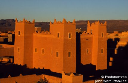 Morocco;Draa Valley;N'Koob - Sunrise over the Kasbahs of N'Koob, in the Draa Valley, Southern Morocco.