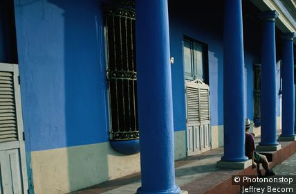 Man sitting outside columned house. Tlacotalpan, Veracruz-Llave, Mexico