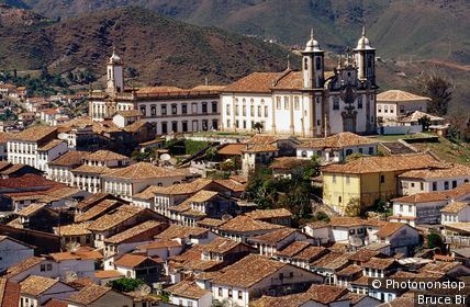 Town rooftops and towers of Museum da Inconfidencia on left and Church do Carmi on right.