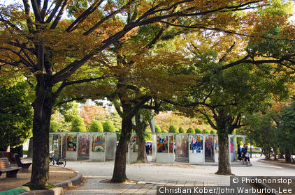 Hiroshima Prefecture, Honshu Island, Japan. Japan, Honshu Island, Hiroshima Prefecture, Hiroshima City, Hiroshima Peace Memorial Park. Children's Peace Monument - Origami Cranes on display under the autumn trees.