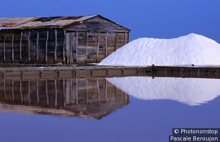 Evaporative saltworks, reflection of salt and house in water, Monte Cristi area.