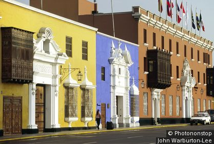 Peru;Trujillo;La Libertad - Elegant facades, wooden balconies and pastel shades typify the colonial mansions on the Plaza de Armas in Trujillo, Peru