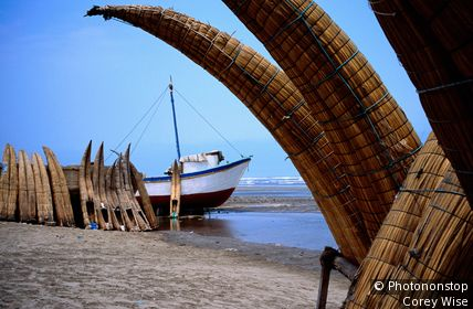 Caballitos or totora reed boats drying beach. Pimentel, Lambayeque, Peru