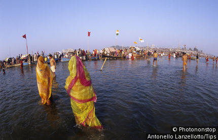 India,Uttar Pradesh, Allahabad (Prayag),Kumbh Mela holy Festival. Women bathing in Sangam river