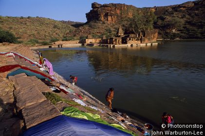 India;Karnataka;Badami - Ancient capital of the Chalukyas, who ruled the Deccan from the 4th to 8th centuries, Badami's Agastya Lake reverberates to the thwack of beaten laundry and the chatter of local women