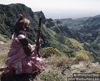 Kenya;Marsabit;Mount Kulal - A Samburu homeguard looks out over the steep-sided gorge of Mount Kulal, which divides the mountain into two. Volcanic in origin, Mount Kulal rises to over 6,000 feet in Northern Kenya and is surrounded by a sea of lava