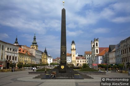 Slovaquie, Slovakia, Banska Bystrica - Soviet monument with the Church of Saint Francis Xavier in the background
