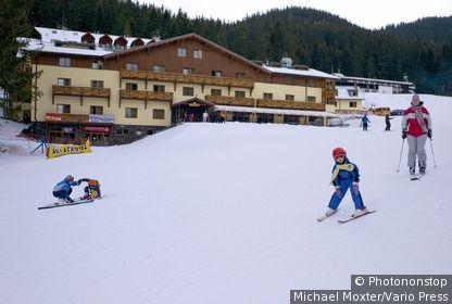 Skiing area in Jasna, behind the ski run Lukova with the Hotel Druzba, Demaenovska Dolina, the low Tatra Mountains, Slovakia. (Jasna, Slovakia)