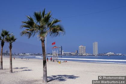 Chile;Region 1;Iquique - Playa Cavancha, the most central of Iquique's city beaches. At the far end are high rise buildings housing some of Iquique's top hotels. Situated on the Pacific coast at the foot of the 800-metre coastal cordillera, Iquique