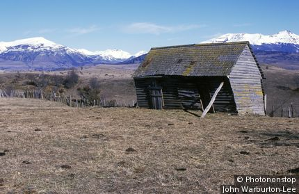 Chile;Northern Patagonia. - Old barn, weathered & warped seen from the Carretera Austral, near Coyhaique