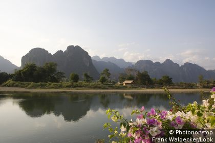 Karst mountains at the river Nam Xong in the sunlight, Vang Vieng, Vientiane Province, Laos