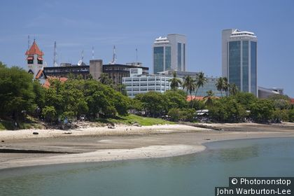 Tanzania, Dar es Salaam. Modern glass skyscrapers stand alongside older buildings on Dar es Salaam's coast.