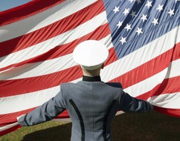 Citadel cadet with American flag